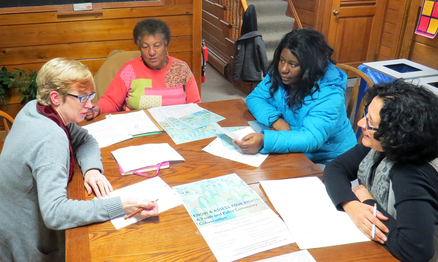 Director of Ontario/Yates Counties Center for Dispute Settlement Kim Reisch, Director of the Geneva NAACP Lucile Mallard, Director of Intercultural Affairs Alejandra Molina and X plan the upcoming youth and police community forum ​as part of the Community Compact meeting in the Office of Intercultural Affairs.