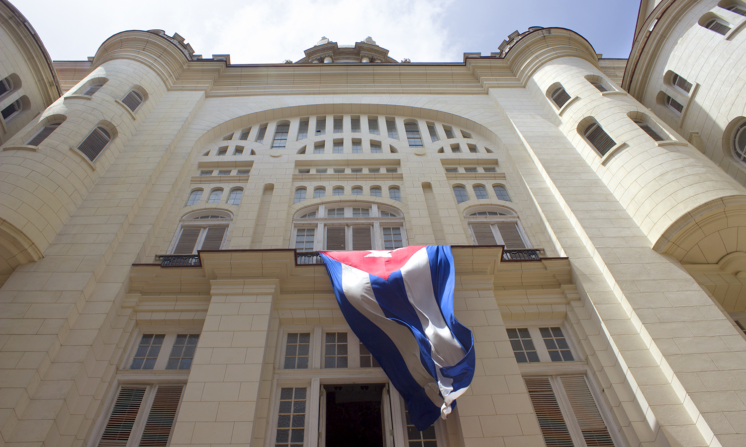 The Cuban flag hangs above the entrance to the Museum of the Revolution, the building that was once the Presidents Palace in Old Havana.