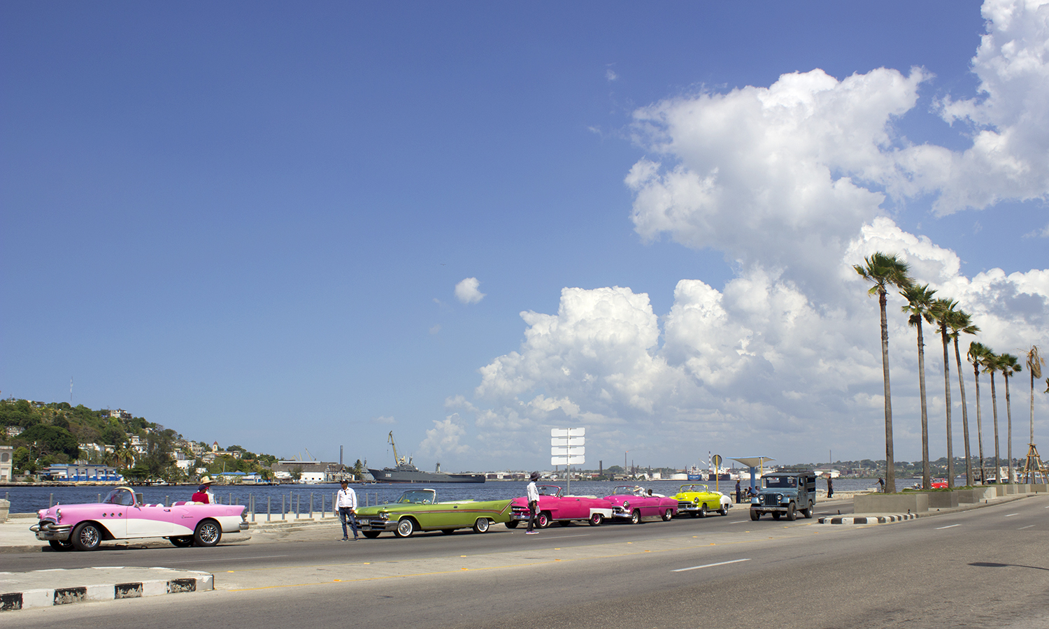 Taxi's wait for passengers on the Malecón in Old Havana.