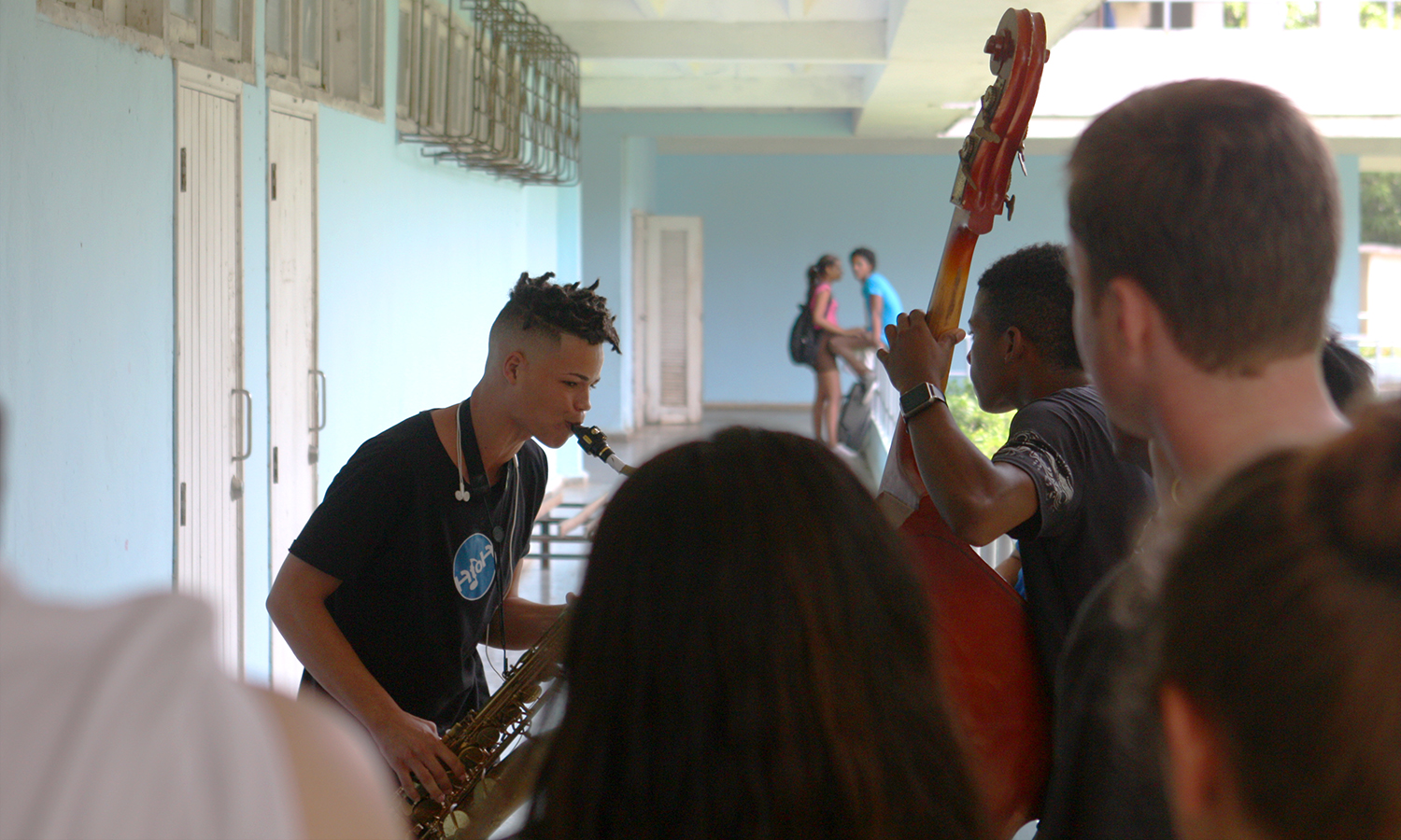 A student studying at the National School of the Arts plays his saxophone for the HWS group.