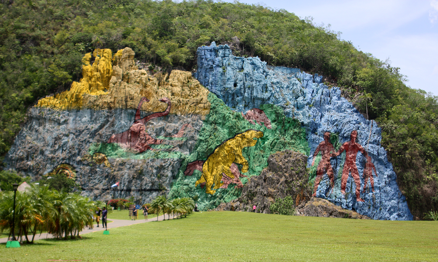 A mural depicting prehistoric creatures whose remains were dug up at this location, is painted on the side of a mountain in Viñales.