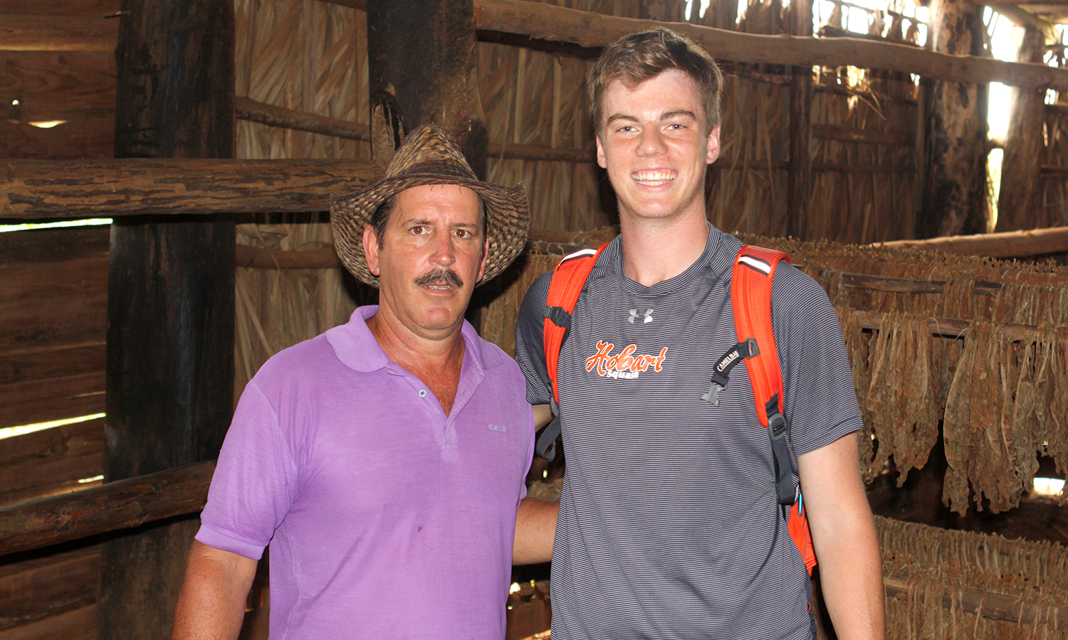 After learning how authentic Cuban Cigars are made, Jack Shannon '18 takes a picture with the owner of the tobacco plantation.