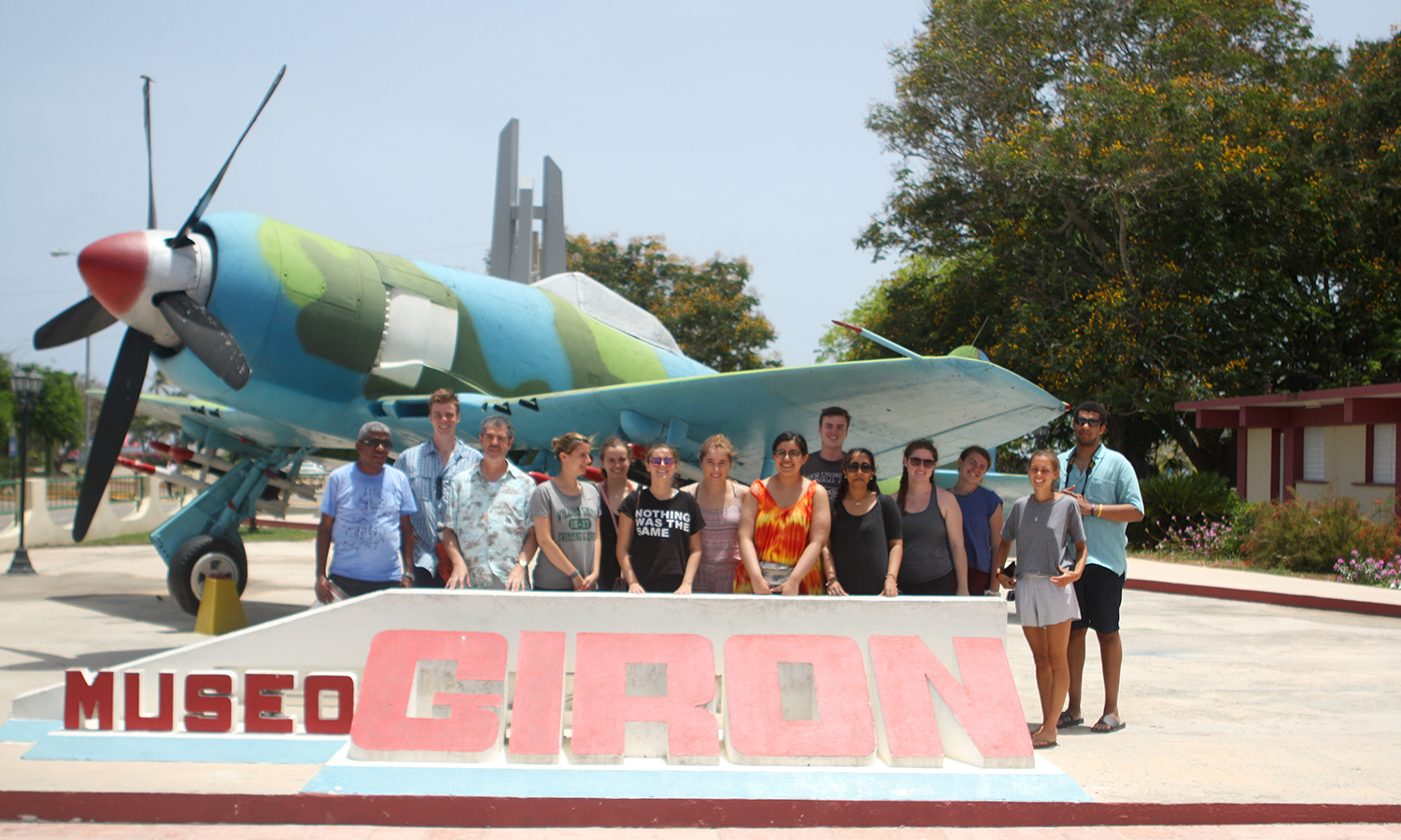HWS students accompanied by Professor Juan Liébana and Cuban expert and guide Edelso Moret, pose for a picture outside the museum of the Bay of Pigs.