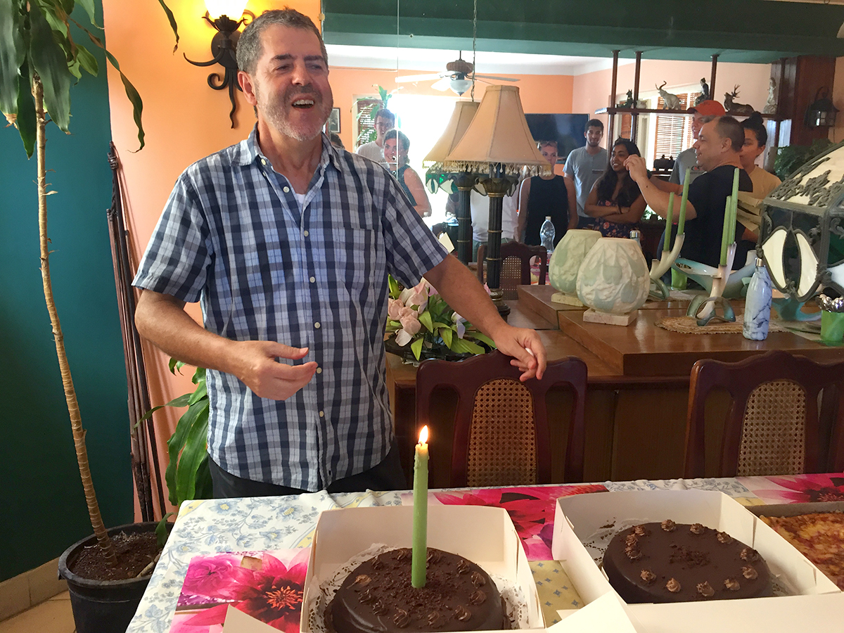 On the last day in Cuba, Professor Liébana waits to blow out his birthday candle, as HWS students surprise him with a day of birthday celebrations.