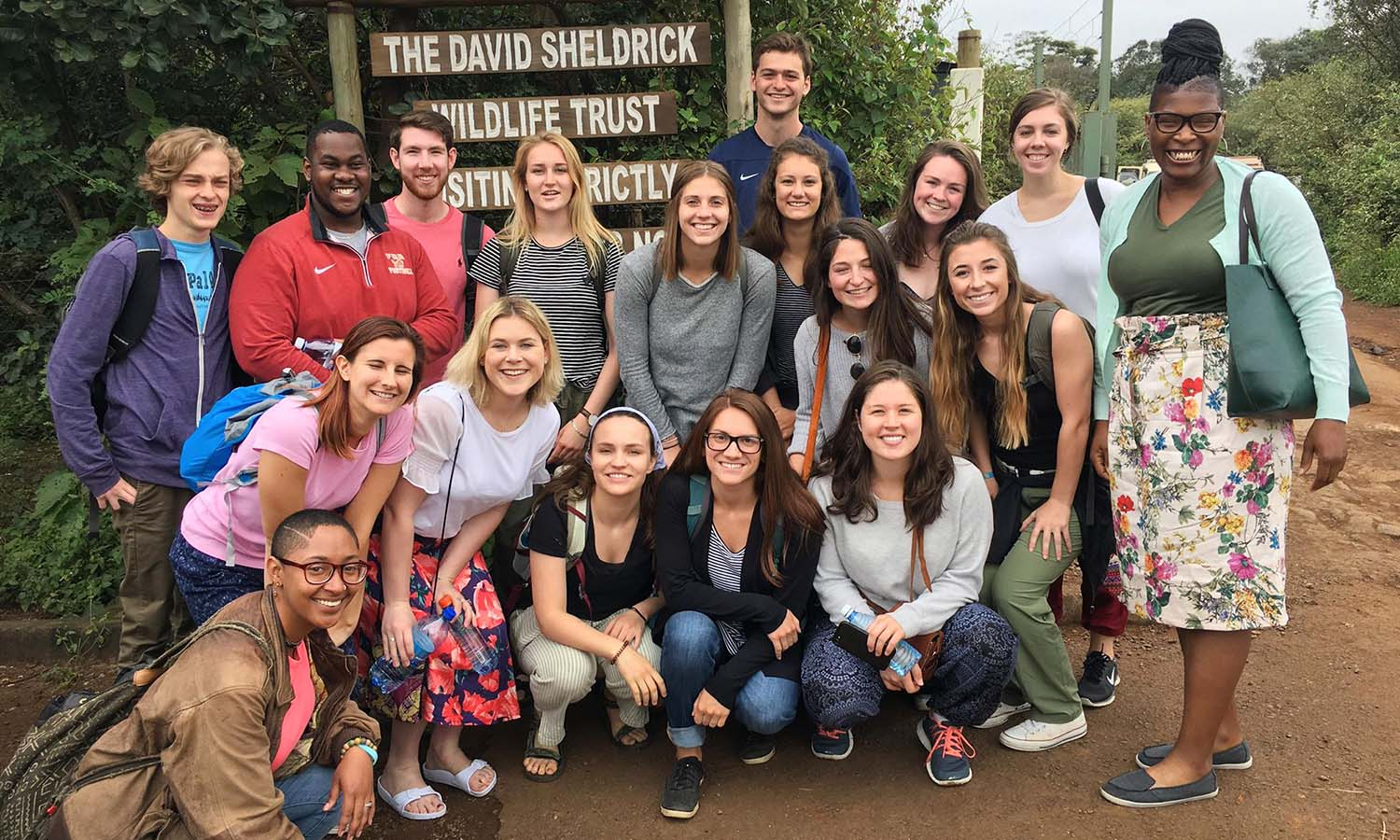 "In this special edition of This Week In Photos, we're showcasing HWS students, faculty and alums on trips all over the world this summer featuring ""The Economics of the Between"" in Kenya, ""Outdoor Education: Theoretical Issues in Outdoor Pursuits"" in Wales, and  ""An Italian Road Less Traveled: Calabria and Sicily"" in Italy. Here, students gather for a photo with Professor Keoka Grayson in front of the David Sheldrick Wildlife Trust in Nairobi, Kenya."