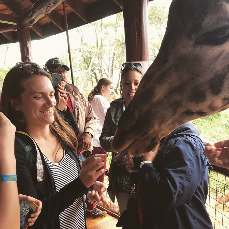 Elizabeth Anderson '19 feeds a freindly giraffe at Samburu National Reserve.