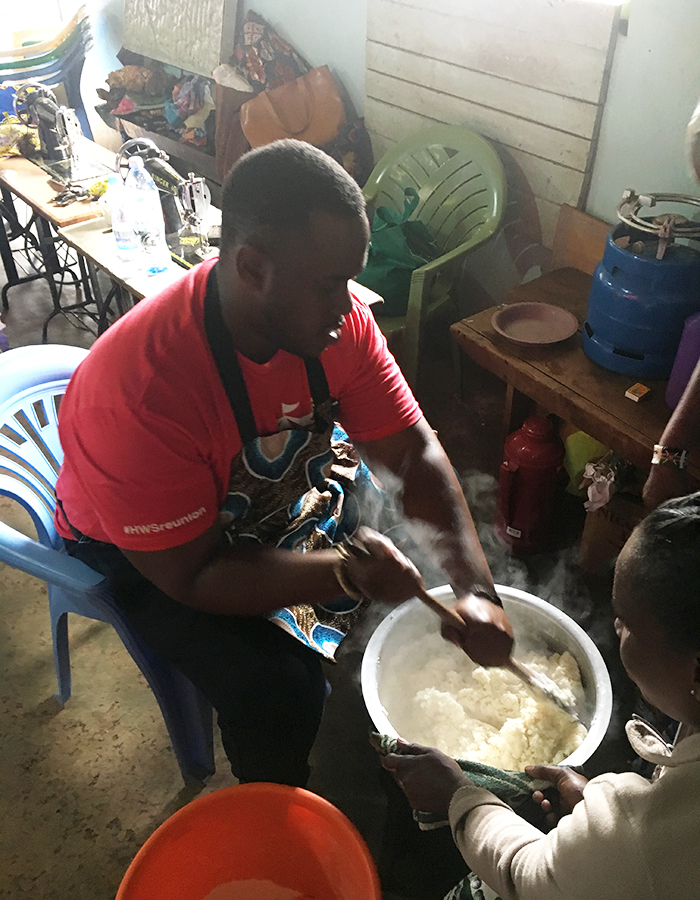 Josiah Bramble '19 mixes ugali, a traditional dish made from maize flour, with members of the Power Women Group.