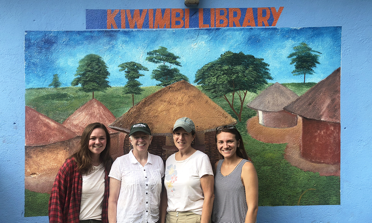 Sarah Banta '19, former HWS Trustee Carol Ulmer '72, Janet Selover Wulster '72 and Elizabeth Anderson '19 pose for a photo at with Kiwimbi International, a charity focused on supporting educational resources in rural Kenya and around the world.