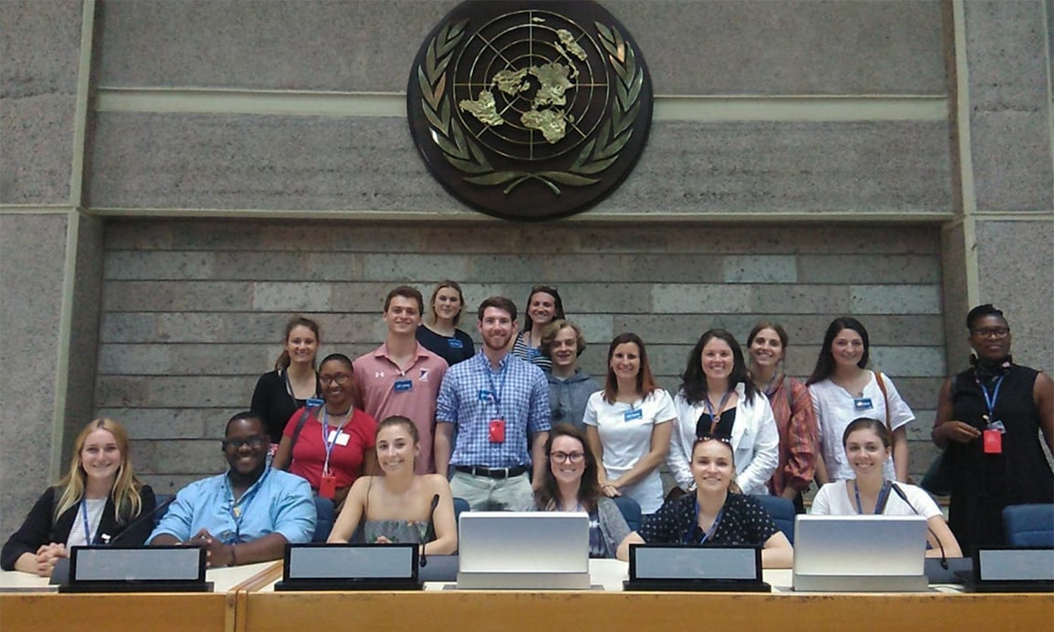 "Students participating in ""The Economics of the Between"" with Assistant Professor of Economics Keoka Grayson gather for a photo during a visit to the The United Nations Office in Nairobi, Kenya."