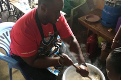 Josiah Bramble â19 mixes ugali, a traditional dish made from maize flour, with members of the Power Women Group.