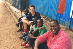 Sam Eaton 'X and Josiah Bramble â19 gather for a photo with local children on the streets of Nairobi, Kenya.