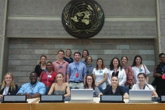 Students participating in âThe Economics of the Betweenâ with Assistant Professor of Economics Keoka Grayson gather for a photo during a visit to the The United Nations Office in Nairobi, Kenya.