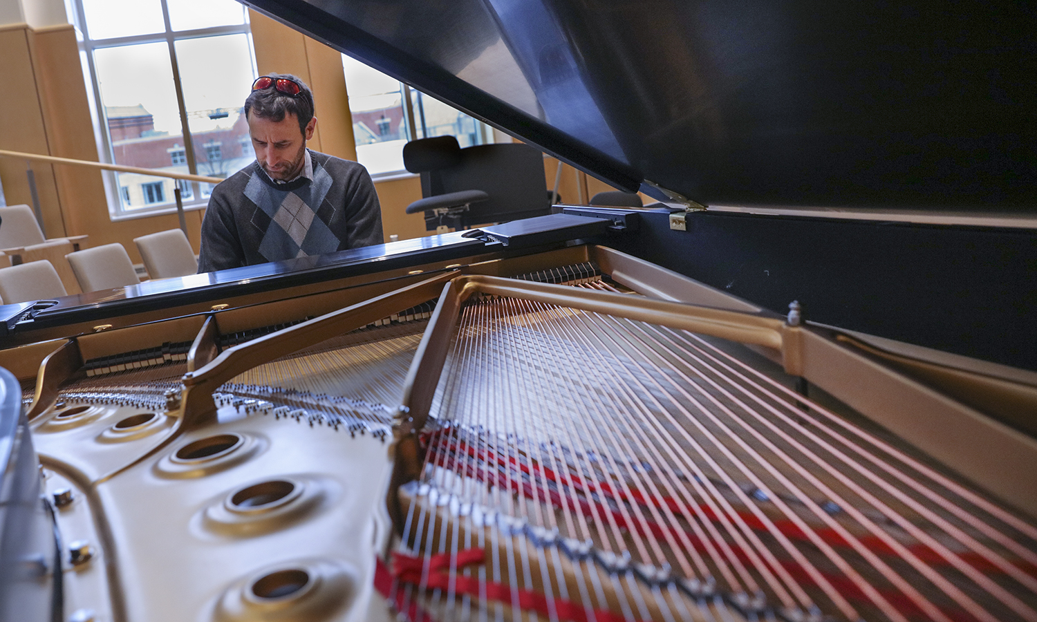 The new Steinway Piano delivered to the Gearan Center for Performing Arts. Mark Olivieri Arts Assistant Professor of Music plays the piano.