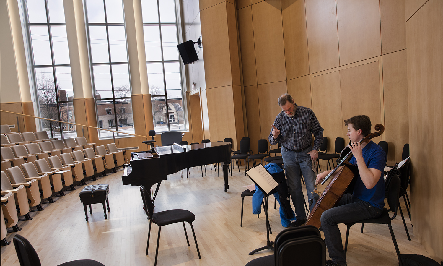 First Day of Classes in the Gearan Center for Performing Arts. Walden Bass, Applied Music Instructor works with ????? on the first cello lessons in  Froelich Hall
