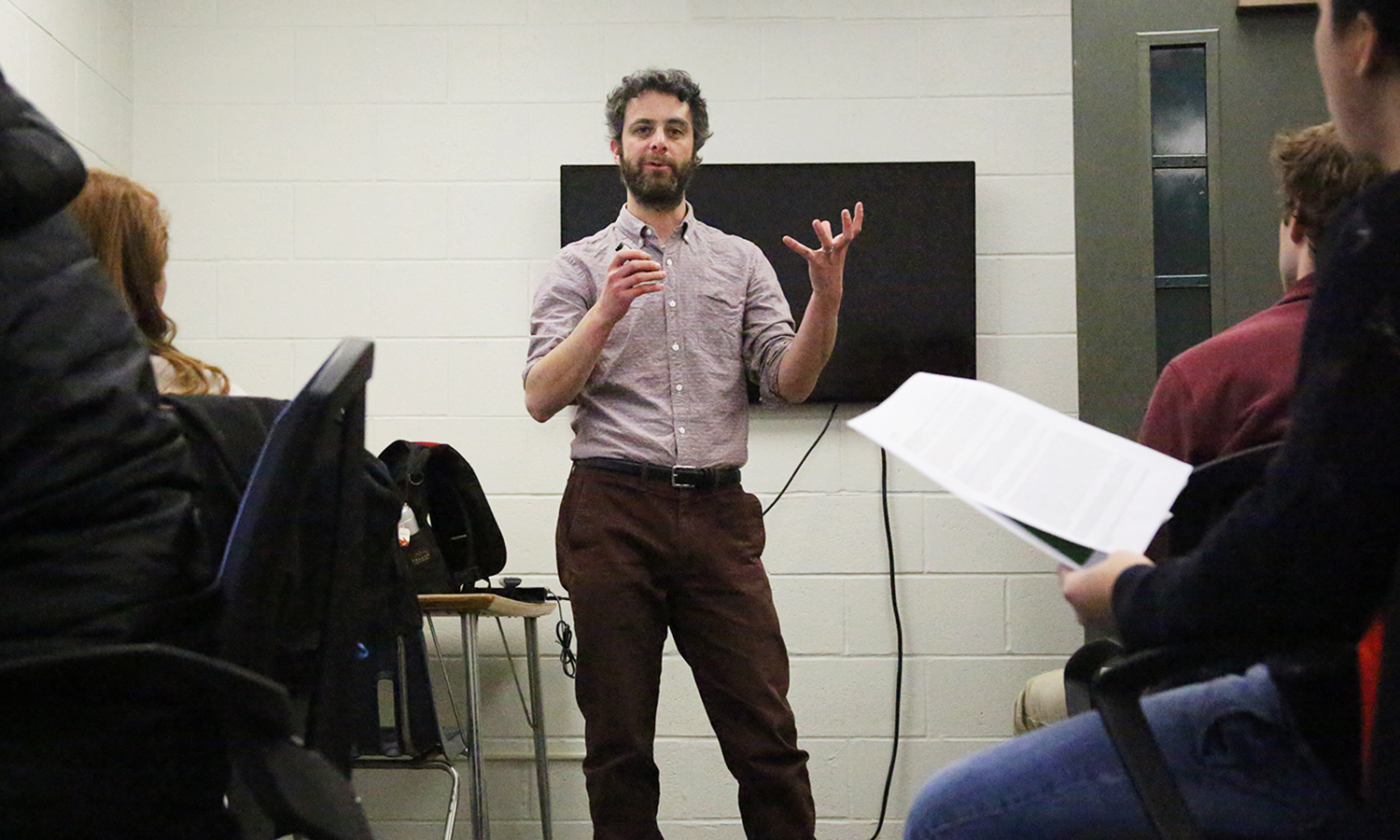 "Assistant Professor of Psychology Daniel Graham explains a neuroscience experiment to students in his ""Research in Sensation and Perception"" class in Gulick Hall."