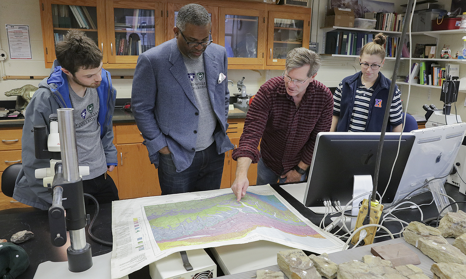 HWS President for a Day winnter Joe Estrin '20, President Greogry J. Vincent '83, Associate Professor of Geoscience David Kendrick and Racheal Barry 'X examine fossils in Rosenberg Hall.