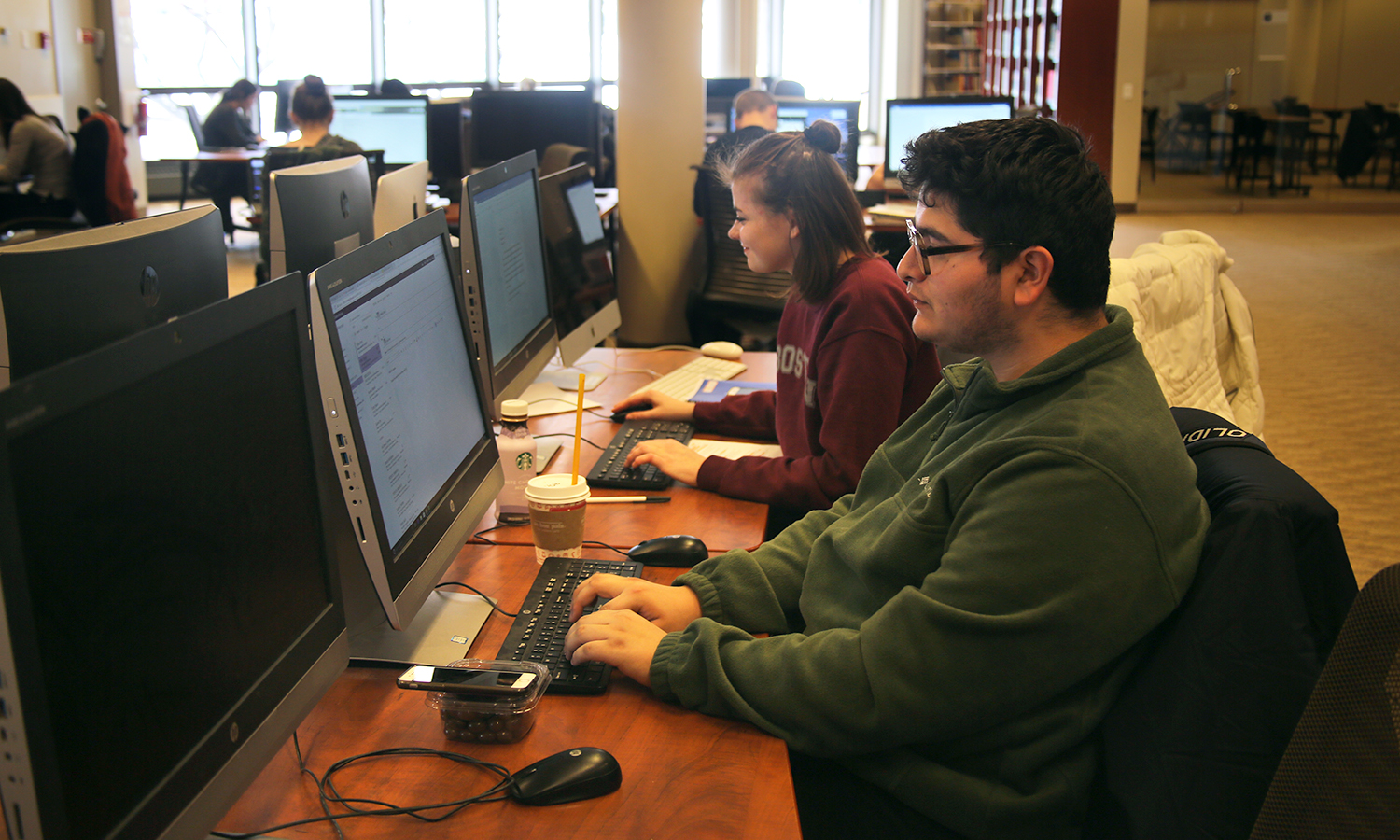Kevin Cervantes 'X and Christina Hunter 'X works on an assignment in the Rosensweig Learning Commons in Warren Hunting Smith Library.