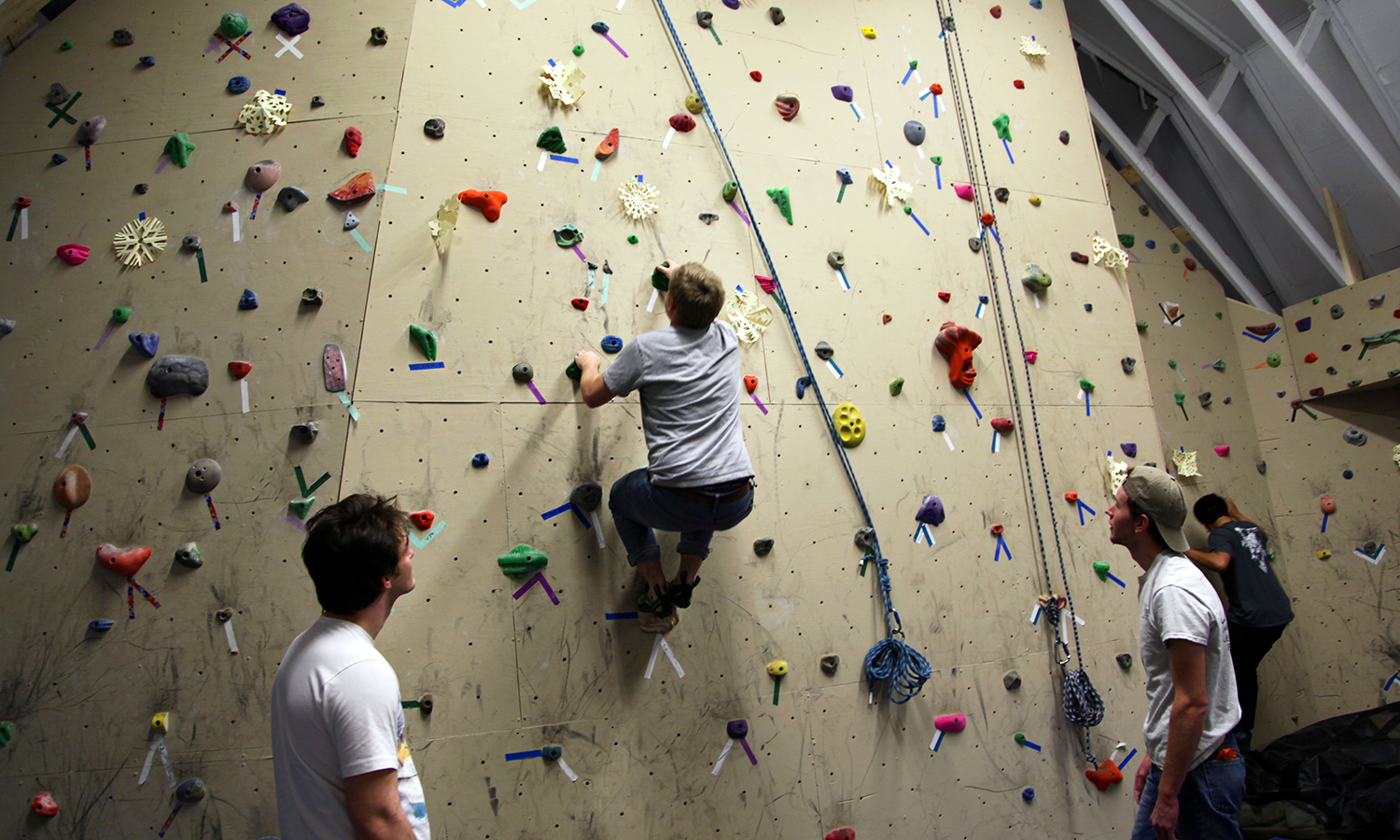 "In the Barn, students climb the rock wall as part of ""Winterfest"" hosted by the HWS Outdoor Recreation Adventure Program."