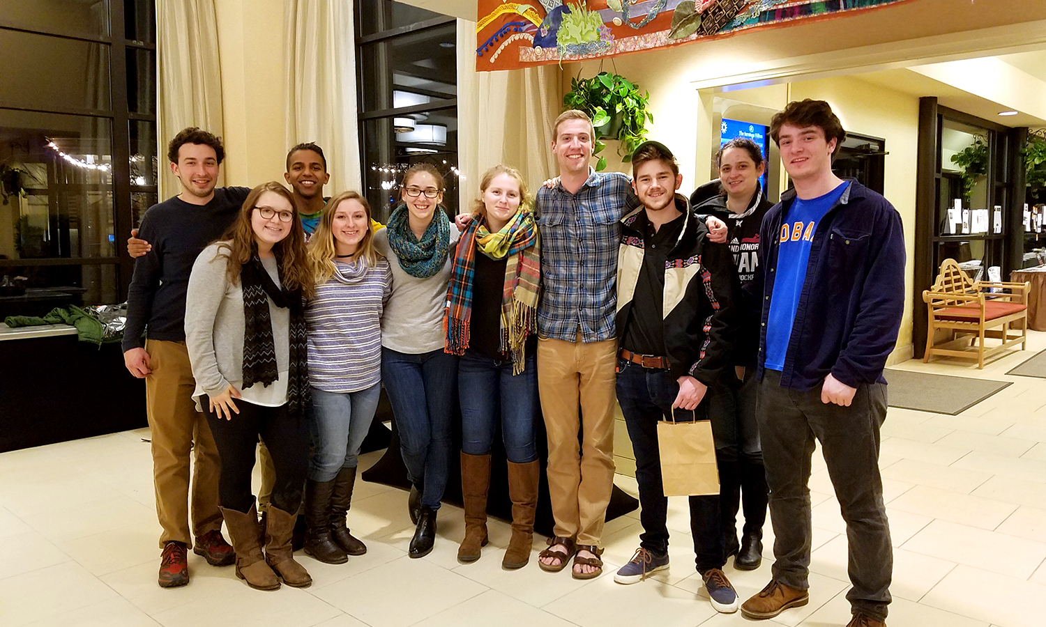 Students in the Sustainable Living and Learning Community (SLLC) Program with Assistant Professor of Environmental Studies Robin Lewis pose for a group photo at the Northeast Organic Farming Association – New York (NOFA-NY) Conference in Saratoga Springs, N.Y.