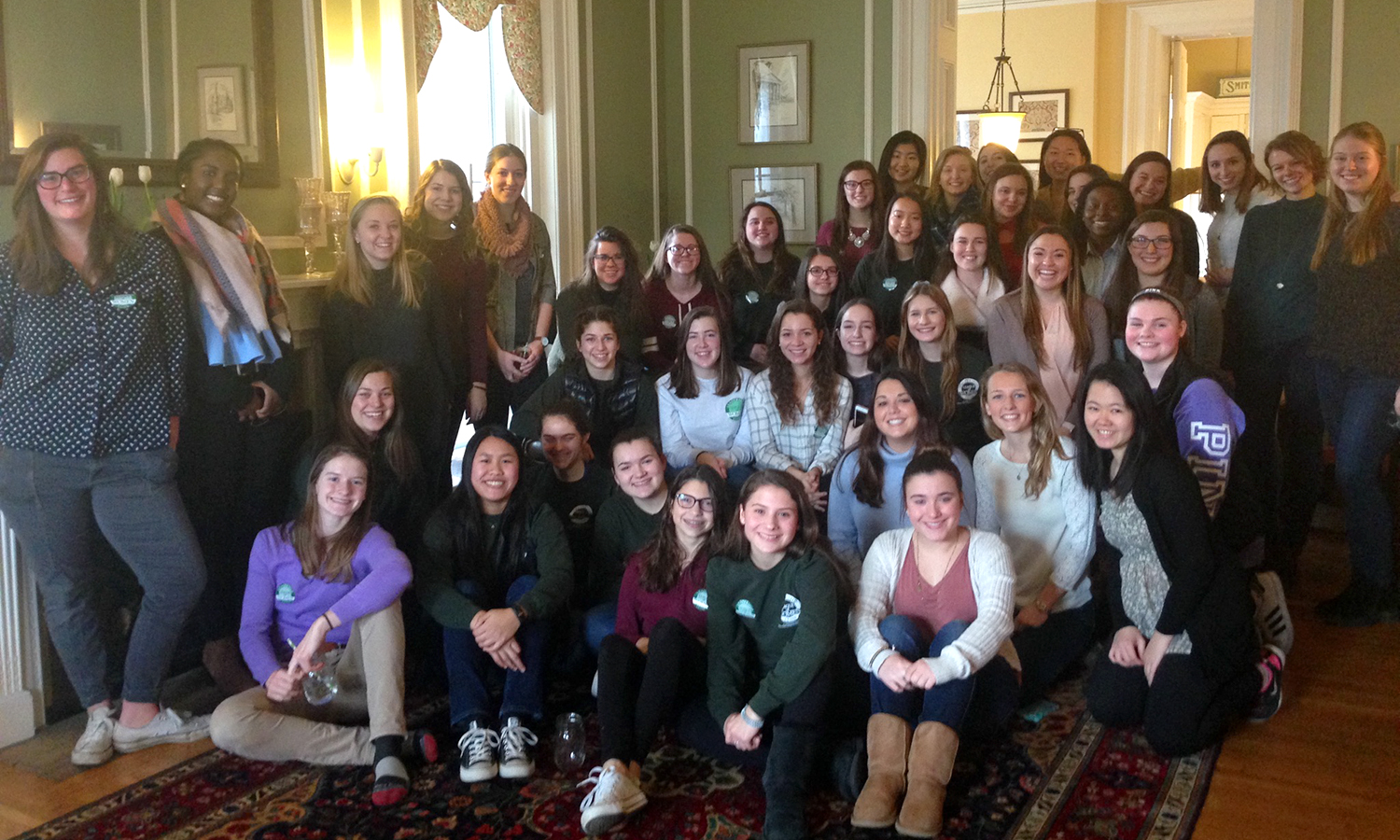 Members of the William Smith Laurel Society and Geneva High School students pose for a group photo at the Leadership League of Women Welcome Back Reception at the William Smith Inn on Sunday.