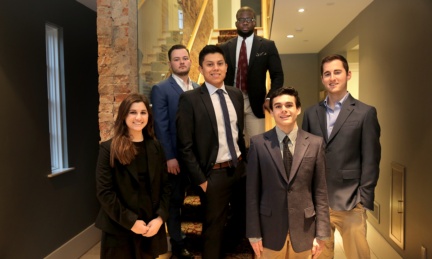 The Stu Lieblien '90 Pitch Contest finalists Dominique DeReubis '18, Gyuri Dragomir '18, Angel Salas-Espana '19, Ato Bensti-Enchill, Max Zibitsker '19, and Sam Solomon '17 pose for a photo in the Centennial Center for Leadership.