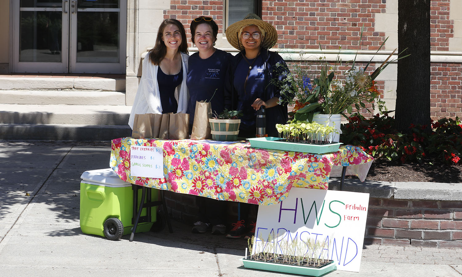 Finger Lakes Institute (FLI) Pulse Project Intern Lara Johnson '19, FLI Food Systems Program Manager Sarah Meyer, and HWS Fribolin Farm Intern Sarah Garcia '17 work together at the summer 2016 weekly HWS Farmstand selling campus grown produce.
