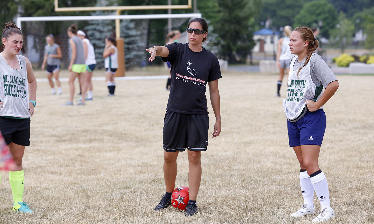 BreLynn Nasypany '11 explains a drill to campers during last week's Heron soccer camp. Nasypany, who was recently named the head coach for RPI's women's soccer team,  will be one of eight Herons inducted into the Heron Hall of Honor on October 15.
