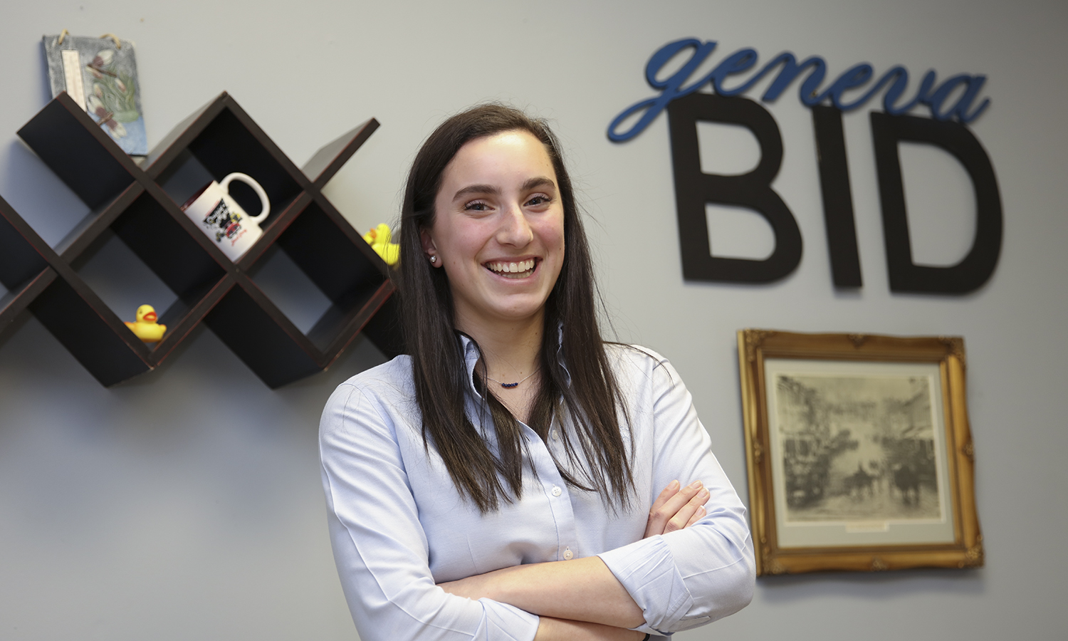"""Peggy Wagner '21 poses in the Geneva Business Improvement District (BID) Office. Wagner is spending her summer interning for the BID and preparing for """"Curisin' Night"""", a large festival held in Geenva, N.Y. This year the event will be held on Friday, July 27th."""