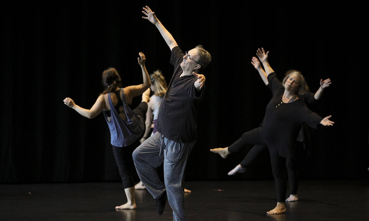 """Professor emeritus of the University of New Mexico and professor emeritus from the College at Brockport, SUNY Bill Evans performs with dance faculty from colleges across the world during the Somatic Dance Conference, """"Making Your Corner of the World a Better Place: Somatics, Science, Pedagogy and Performance"""" in Deming Theatre. The conference, organized by Professor of Dance Cynthia Williams and Evans, brought more than 75 keynote presenters and performers to the Gearan Center for the Performing Arts."""