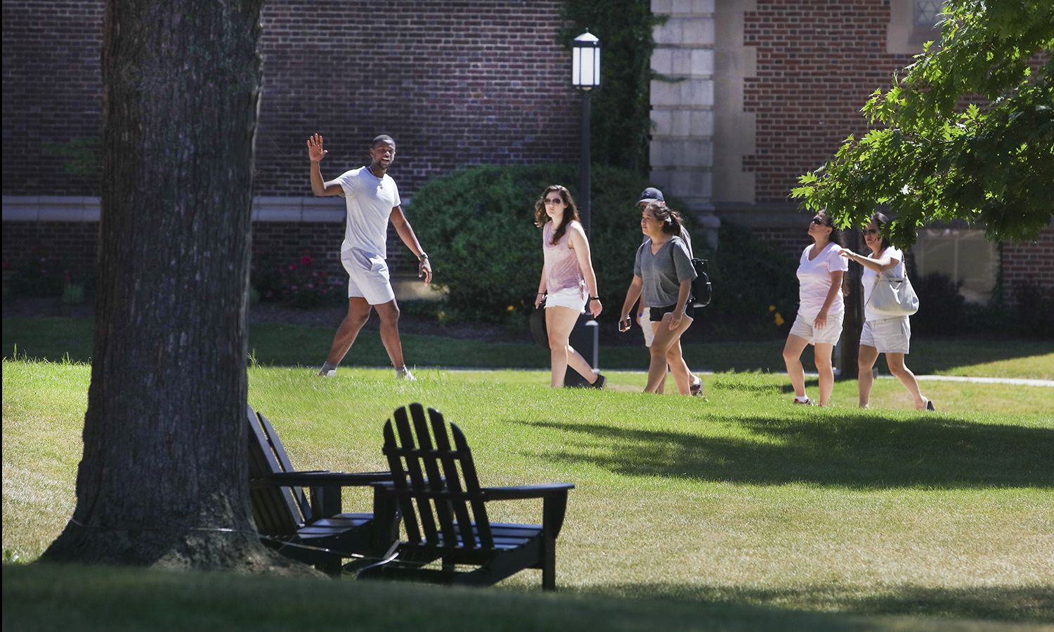 Admissions tour guide Edens Fleurizard '20 leads a group of prospective students through campus.