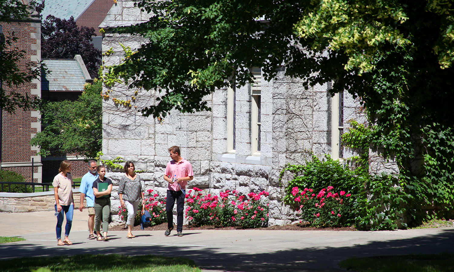 Jon Hartnett '19 leads an admissions tour for prospective students outside of of Demerest Hall.