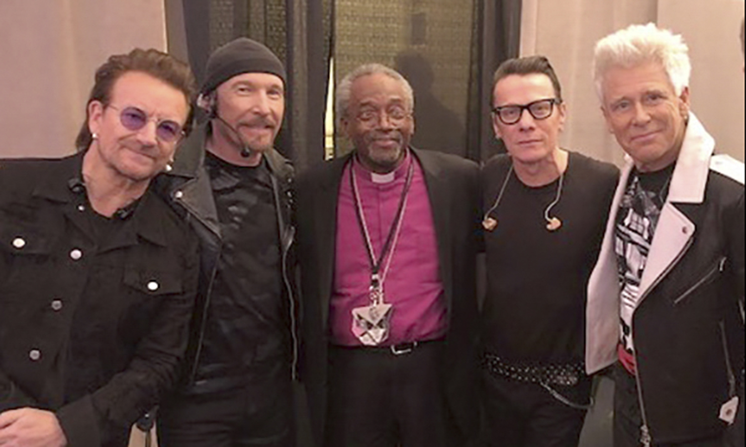 The Most Rev. Michael B. Curry '75 meets backstage with members of U2 after a concert at Madison Square Garden.