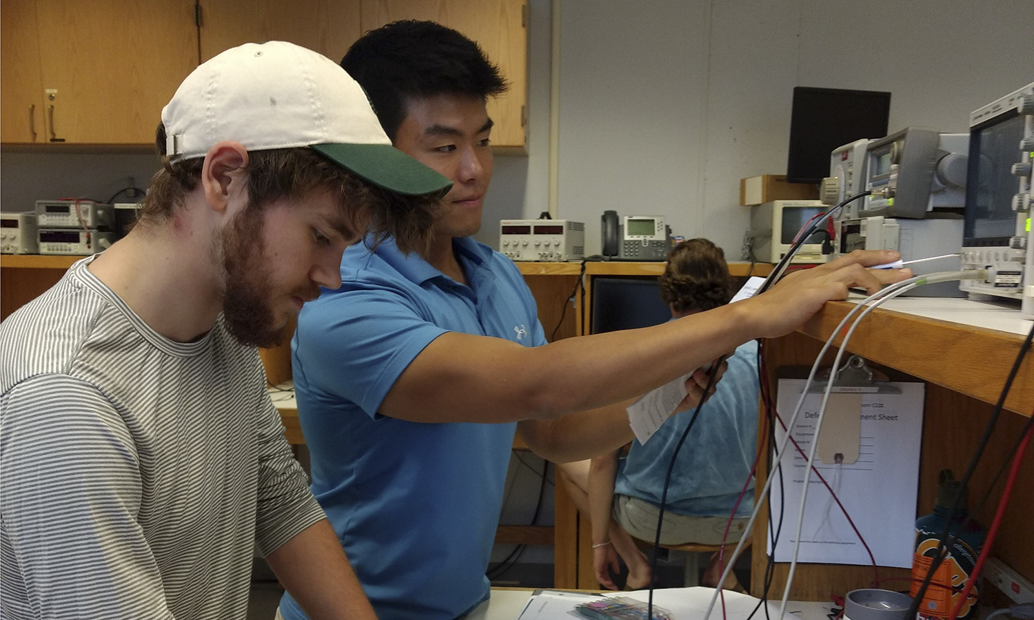 Daniel Choe '16 and James Monaco '20 in an electrical engineering course. Choe and Monaco are both participating in the Dartmouth joint degree program this summer with Choe working as a TA post grad at Dartmouth.