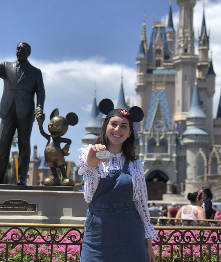 Elise Wyatt '18 poses in front of the Magic Kingdom in Orlando, Florida. This summer, Wyatt is  interning at Walt Disney World as a part of the Disney College Program. Wyatt is gaining experience in the hospitality industry at the Disney Contemporary Resort Marina.