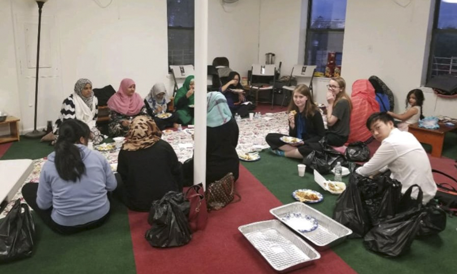 Elizabeth Dunne '19 speaks with members of a local mosque about their experiences growing up in New York City, through her summer position as a Legislative Affairs intern for the office of Assemblyman Brian Barnwell, representative of the 30th Assembly District in New York.