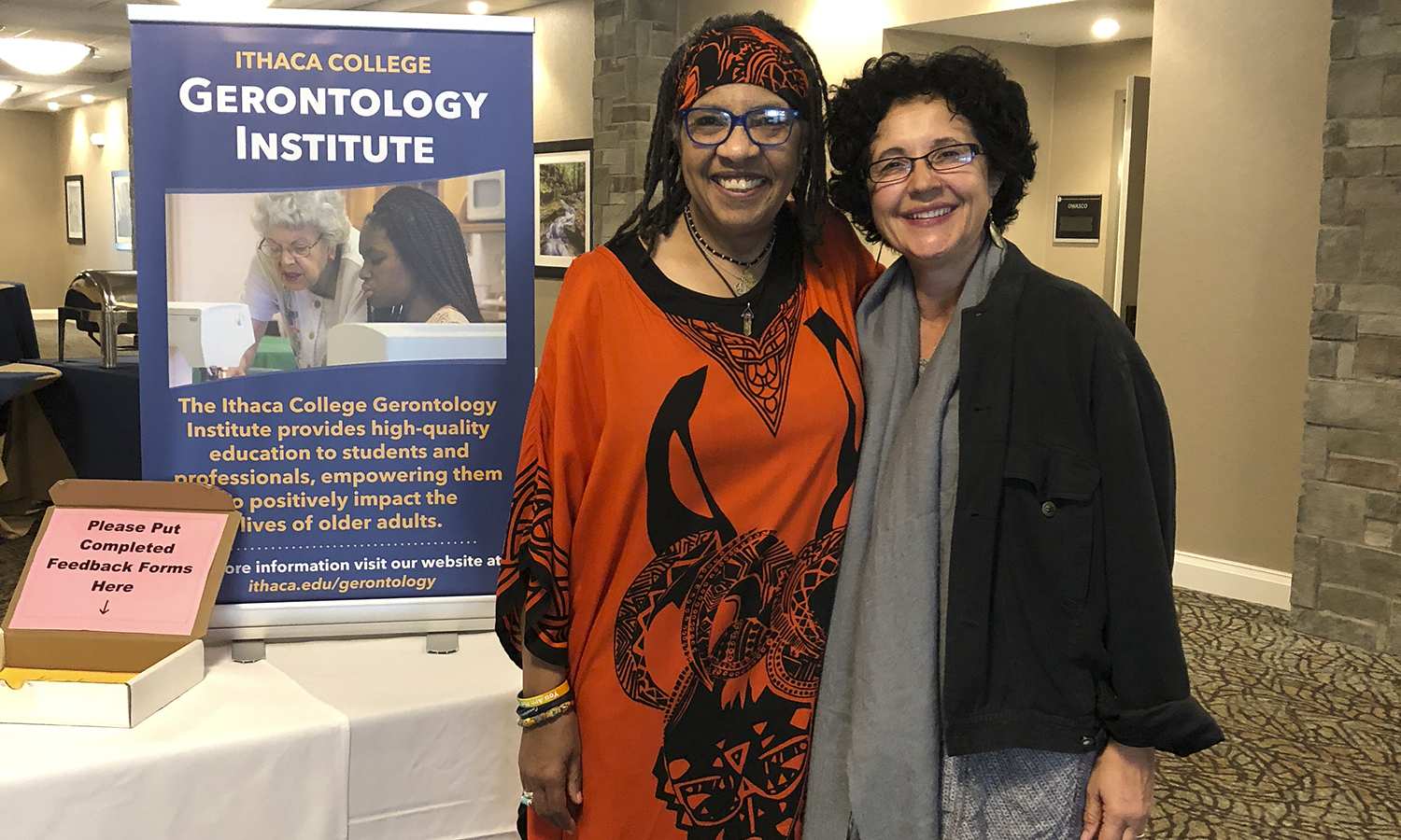 Director of Intercultural Affairs Alejandra Molina (right) poses with Ednita Wright, Ph.D, LCSW, CASAC and Professor of Human Services & Teacher Education, and Program Coordinator for the Alcohol & Substance Abuse Counseling Program at Onondaga Community College. Molina attended the End of Life Care and Cultural Competence Conference in July.