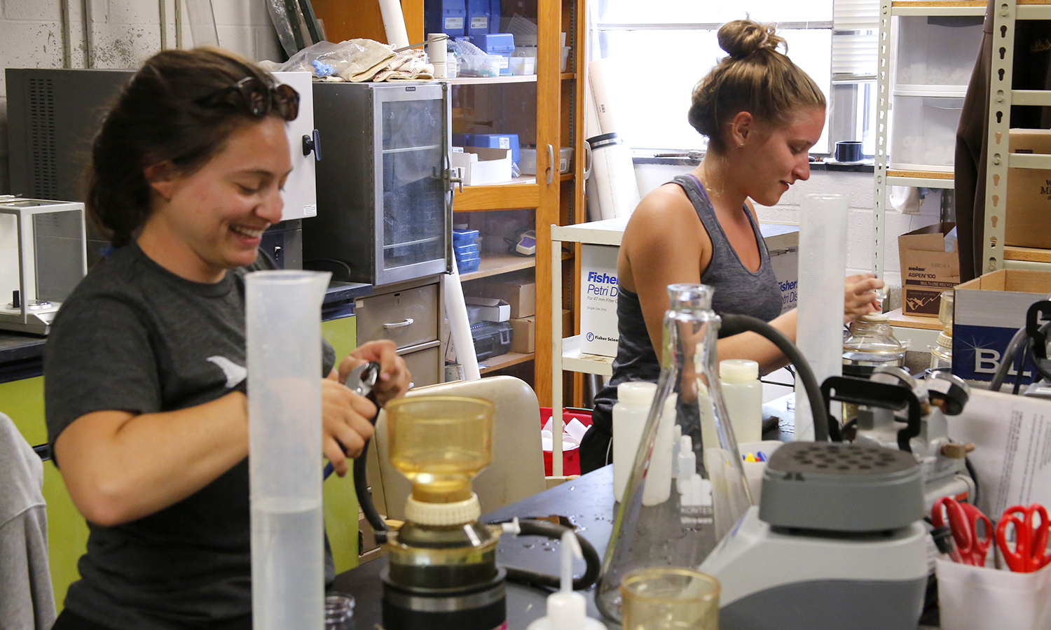 Bethany Kharrazi '21 and Emma Wilber '21 conduct research in Napier Hall. Both students are investigating the water quality of the Finger Lakes and measuring the presence of blue green algae in collaboration with Professor of Environmental Studies John Halfman.