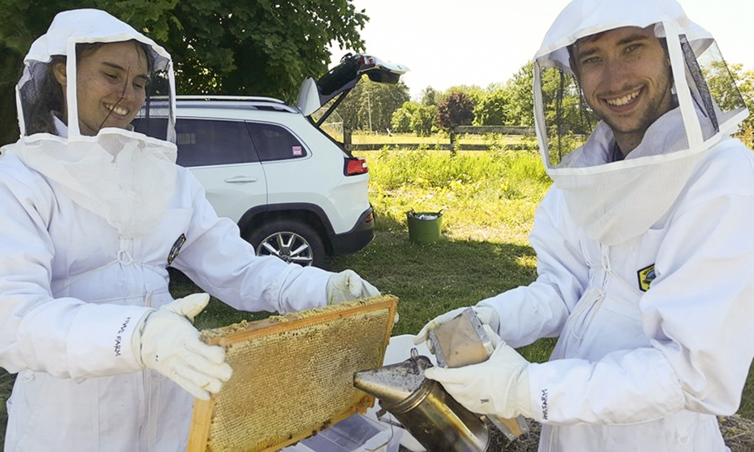 Eileen Rath '20 and Alexander Cottrell '20 extract honey from beehives on Fribolin Farm.