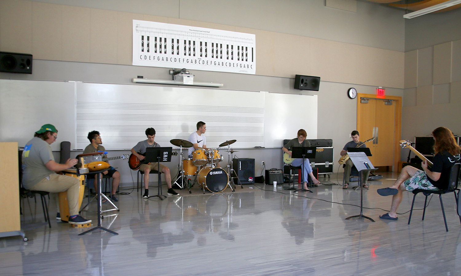 HWS students rehearse for the 2018 Xerox International Rochester Jazz Festival. Guitarists Michael Bruno '19 and Bradley Stewart '19, drummer Nick LaDuca '19 and percussionist Orson Sproule '21 and bass guitarist Jasper White '20 are led by Applied Instructor of Music Greg Wachala (not pictured).