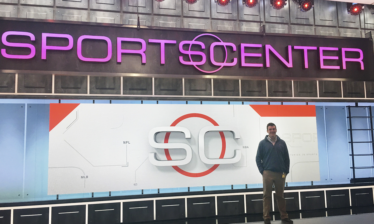 Mac Benson '18 poses in front of Sports Center in New York, N.Y. Benson recently began his career with ESPN as a full time production assistant.