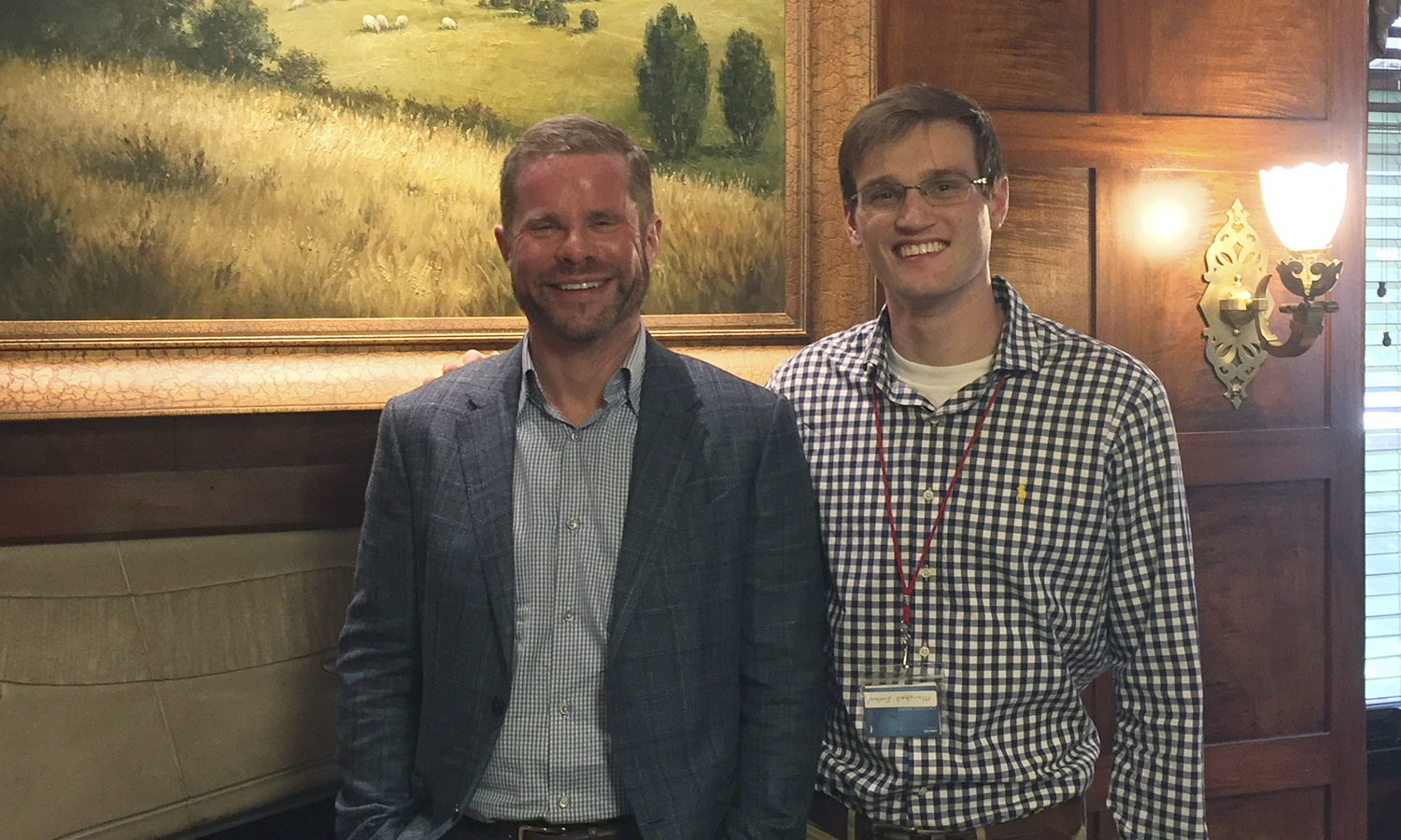 Marshell Ireland '20 poses with the founding partner of Thomas & Solomon in Rochester, N.Y. This summer, Ireland is interning with the firm, specializing in Employment Law.