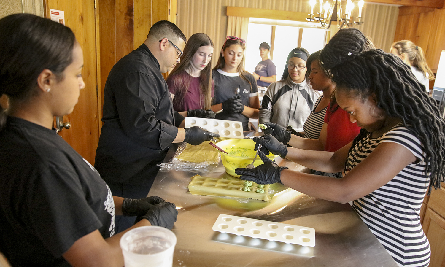 Participants in the HWS Summer Academy prepare ravioli on Fribolin Farm. For more than a decade, the Colleges have hosted the two-week intensive college prep program for Geneva High School students.