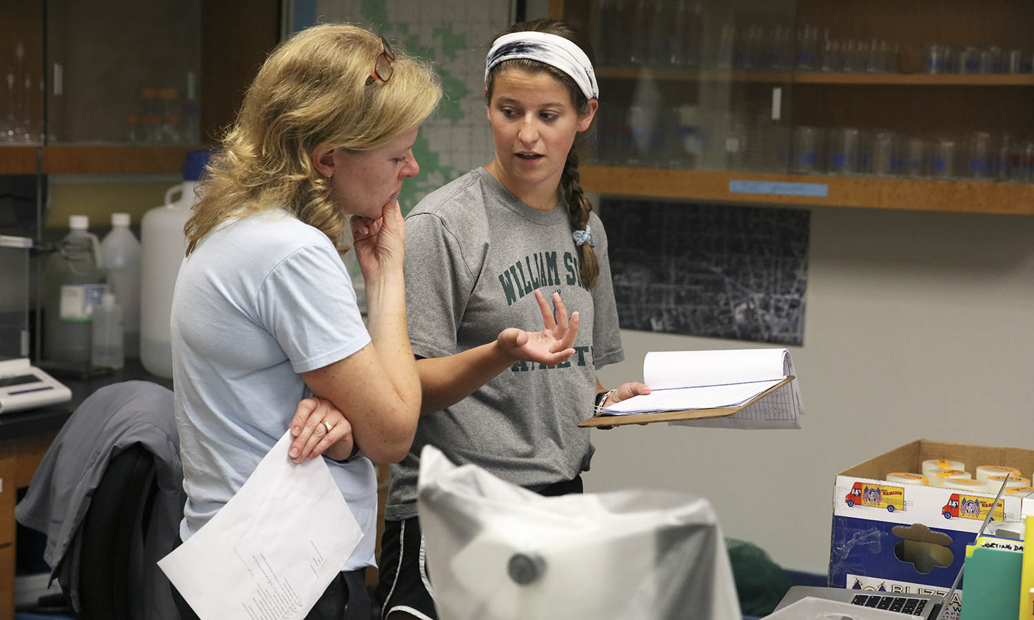 Director of Introductory Biology Labratories Susan Cushman (left) and Kate Foley '20 discuss findings on Foley's research on the Round Goby Fish.