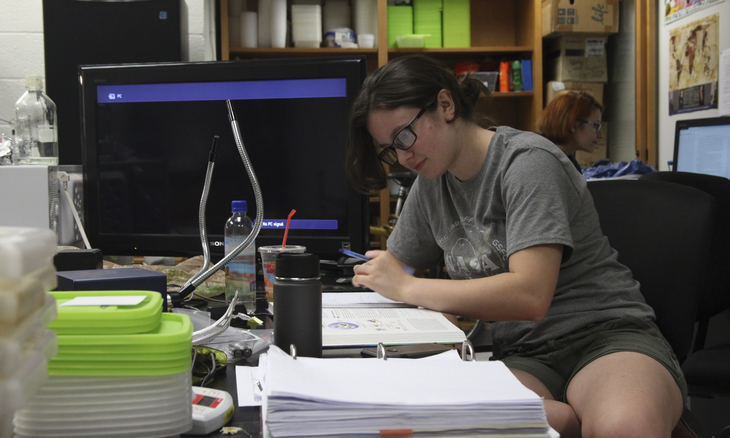 Britta Goncarovs '21 sits taking notes while doing Salamander Research with Professors Cosentino and Droney in the Biology Department