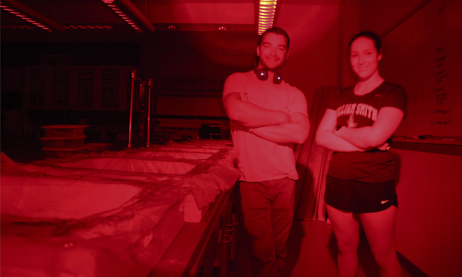 Josh Pugliese '20 and Anna Leffer '20 pose for a photo in the lab. The pair are using infrared lighting to study the behavioral properties of salamanders.