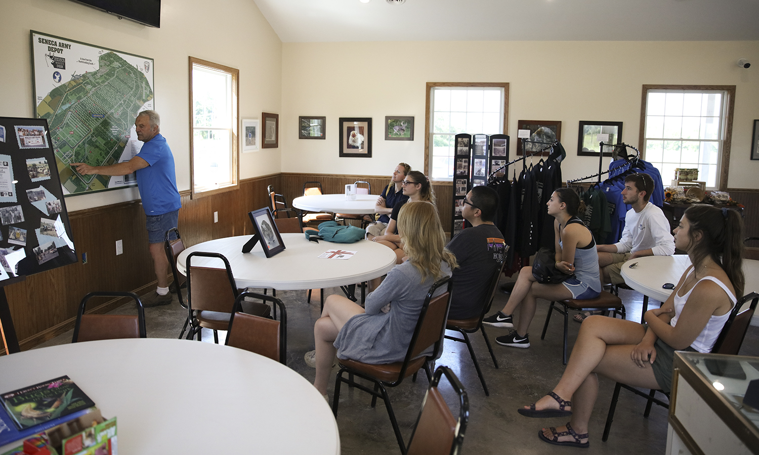 President of Seneca White Deer, Inc. Dennis Money informs a group of students about his organizations' work to preserve the unique wildlife and military history of the Seneca Depot in Romulus, N.Y.