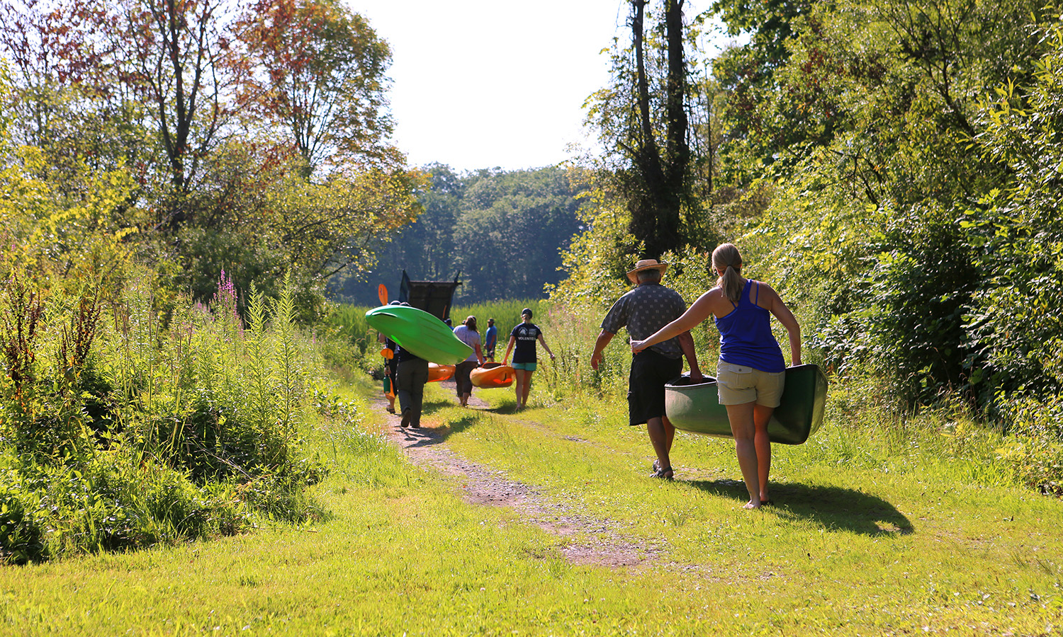 Summer interns for the Finger Lakes Institute, members of the the Nature Conservancy and the Wayne County Soil and Water Conservation gear up to pull water chestnut, and other invasive species, from Sodus Bay