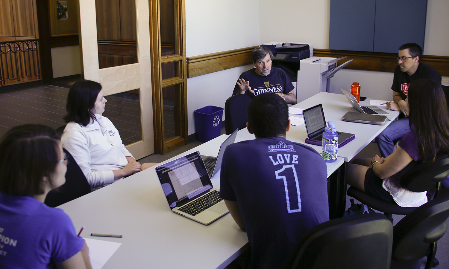 Professor of Biology David Droney and Assistant Professor of Biology Bradley Cosentino discuss recent findings during a meeting with students participating in summer research groups focused on salamaders.