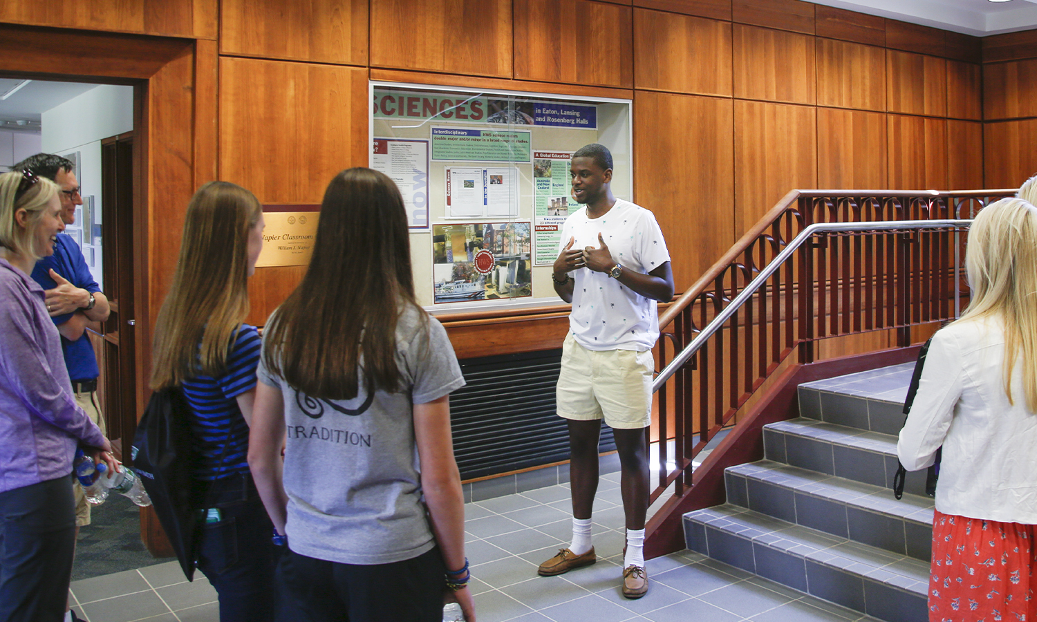 In Napier Hall, Edens Fleurizard '20 chats with prospective students and their families about research oppotunites at HWS during a campus tour.