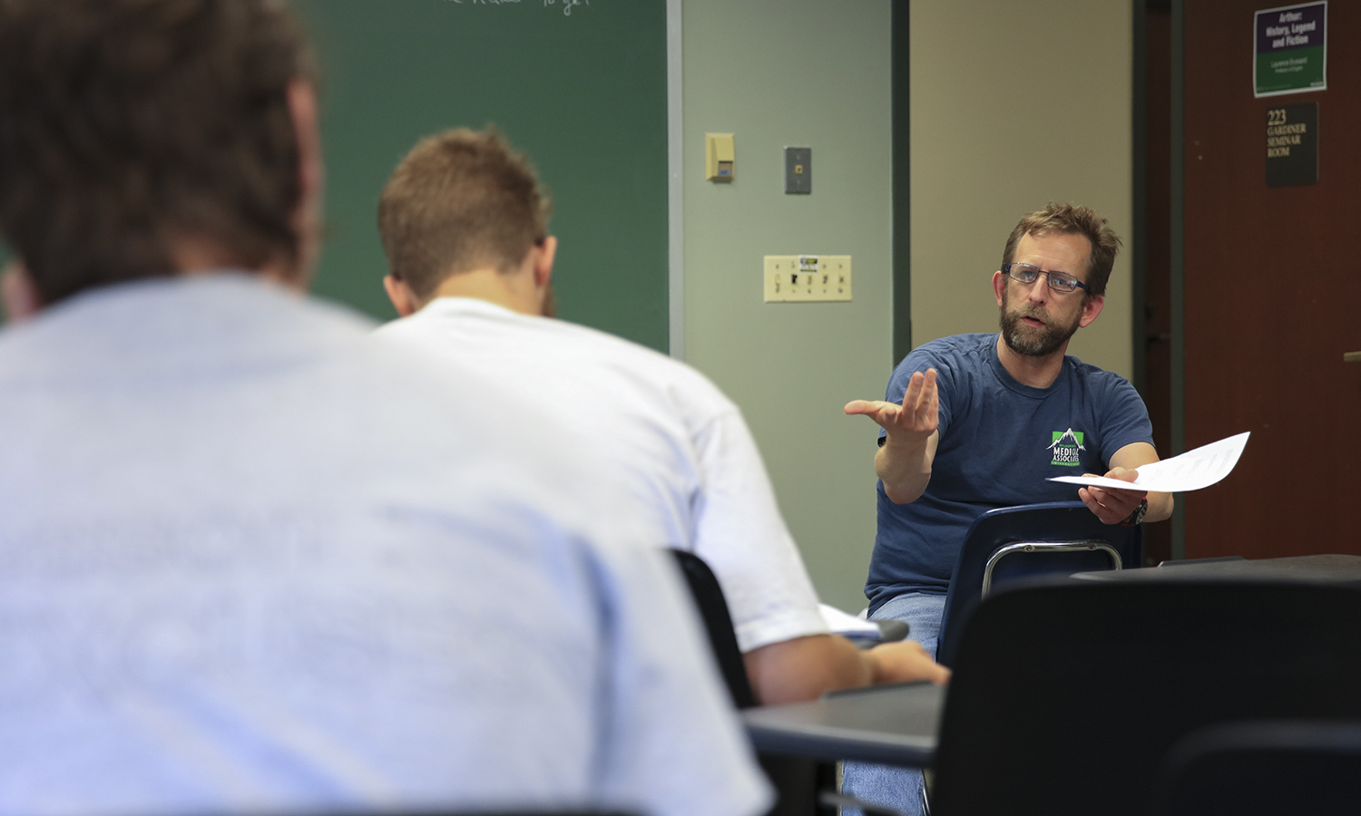 """Assistant Professor Department of Mathematics and Computer Science John Lasseter talks with students as part of his Summer Session course """"Mathematics for Informed Citizenship"""" in Gulick Hall."""
